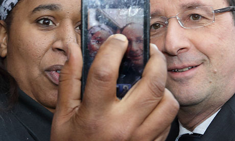 A woman takes her picture with France's President François Hollande on a visit to Gresilles, Dijon