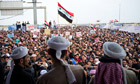 Clerics address a demonstration in Ramadi. Every Friday, crowds have poured on to the streets