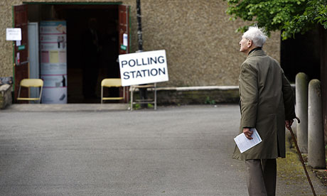An elderly man heads to cast his vote during local elections in London.
