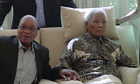South Africa's President Jacob Zuma, left, sits with Nelson Mandela,