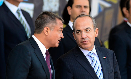 Former Mexican president Felipe Calderón, right, with then federal police chief, Genaro García Luna