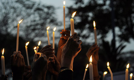 Indian activists at a candlelight vigil in Kolkata after cremation of gangrape victim