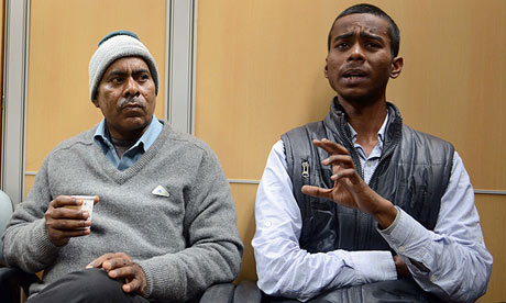 Badri Nath, left, the father of the gang-rape victim, and her brother Gaurav at a press conference.