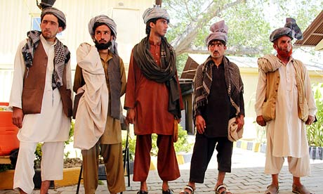 Taliban militants surrender their weapons in Jalalabad