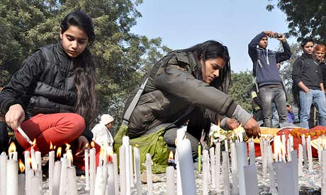 Indian people light candles in memory of a gang-rape victim in New Delhi