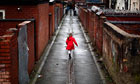 A girl plays in an alleyway in Gorton, Manchester.