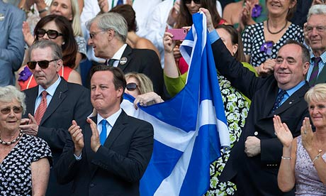 Alex Salmond, Scottish first minister, right, celebrates with a saltire behind Cameron at Wimbledon