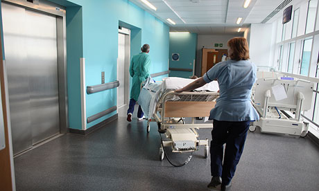 A patient is taken to the operating theatre.