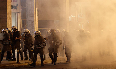 Athens riot police fire tear gas at an anti-fascist protest calling for action against Golden Dawn