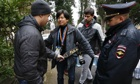 Russian police carry out security checks on a journalist in Sochi.