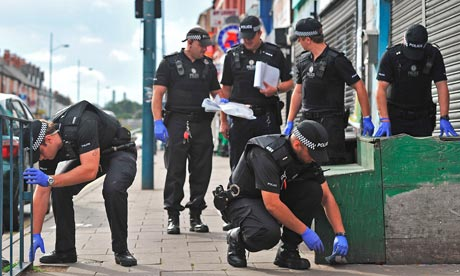 Police in Birmingham search for evidence