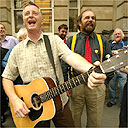 Billy Bragg and MPs protesting the stifling of music outside a pub