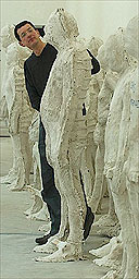 Antony Gormley with some of the 250 plaster casts of people at the Baltic centre