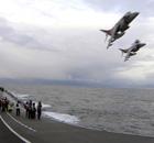 A Harrier GR9 aircraft leave the Royal Navy's aircraft carrier HMS Ark Royal