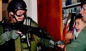 Elian Gonzalez, held by Donato Dalrymple, is taken by U.S. federal agents