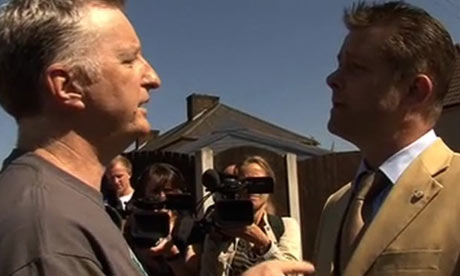 Billy Bragg and BNP councillor Richard Barnbrook arguing on the streets of Dagenham
