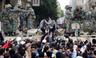 Hundreds of anti-government protesters returned Saturday to the battered streets of central Cairo