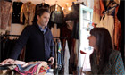 Actor Alastair Mackenzie talks to a lady shopkeeper in an Edinburgh clothes Shop