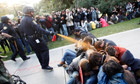 Police officer uses pepper spray on Occupy UC Davis protesters
