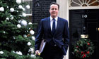 David Cameron next to Christmas tree outside Downing Street