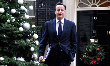 David Cameron next to Christmas tree outside Downing Street