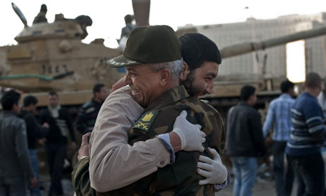 An Egyptian man hugs an army commander in Tahrir Square