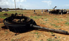A turret of a tank belonging to forces loyal to Libyan leader Muammar Gaddafi is left on the ground