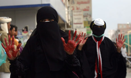 Yemeni women show blood on their hands
