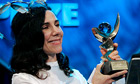 PJ Harvey smiles as she receives the 2011 Mercury Prize in London