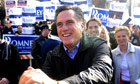 Mitt Romney greets voters outside a polling station in New Hampshire