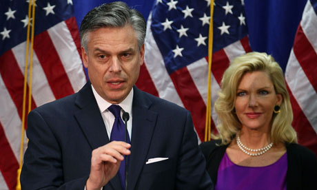 Jon Huntsman, flanked by his wife, Mary Kaye, announces he is quitting the presidential race