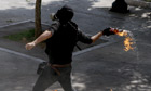 Athens protester throws a molotov-cocktail