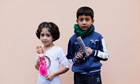 Refugee children pose during the first day of Eid al-Adha at Yayladagi refugee camp