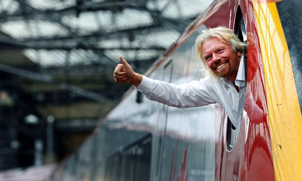 Richard Branson leans out of Virgin train