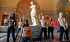 Femen demonstrate in Louvre