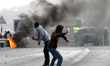 Palestinian youths clash with Israeli soldiers in the occupied West Bank city of Nablus.