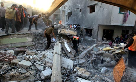 Gaza residents search through debris of Dalou family following Israeli air strike