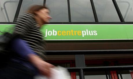 Woman walks past a job centre in 2009
