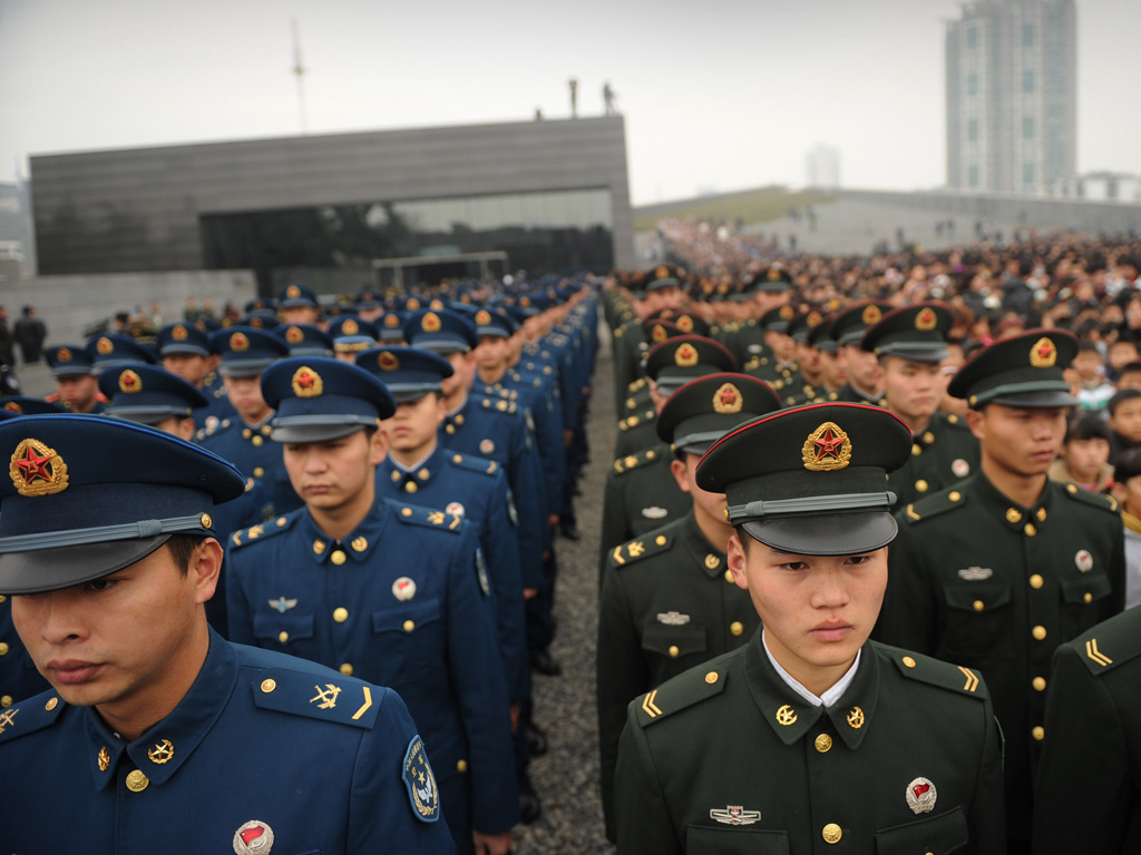 Chinese military attend a ceremony for victims on the 75th anniversary of the Nanjing massacre