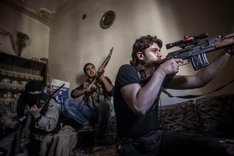 A rebel sniper aims at Syrian army positions in the Aleppo Jedida district