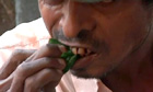 Man in Burma chews betel nuts