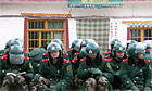 Security forces sitting down in Aba, Tibet.