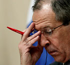 Russian Foreign Minister Lavrov listens during a news conference in Vienna