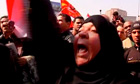 Woman protester in Cairo following football deaths