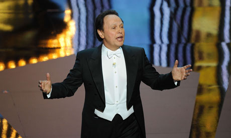 Oscars 2012 host Billy Crystal sings at the start of the 84th Academy Awards