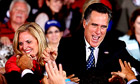 US Republican presidential candidate Mitt Romney greets supporters