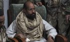 Saif Gaddafi in the custody of rebel fighters after his capture in November 2011