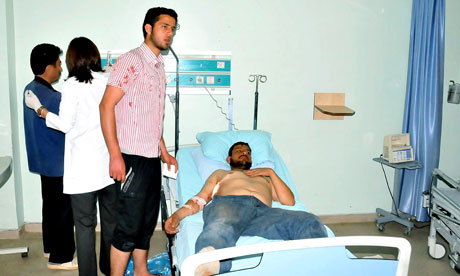 Syrian refugee, wounded in shootings along the border between Syria