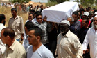 Pallbearers carry the coffin of Megrahi during his burial at a cemetery in Janzour