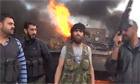 Free Syrian Army celebrating infront of burning governmnet tank